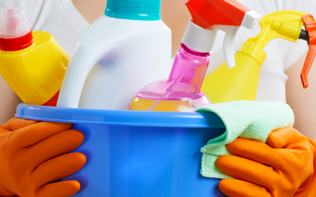 woman holding cleaning chemicals which contain xenoestrogens
